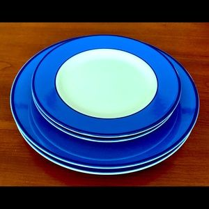Four Italian porcelain plates with thick blue trim
